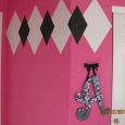Hot pink white and black baby girl nursery with argyle diamonds wall painting technique using paint and faux jewels as bling