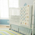 Baby blue and white sailboat nautical theme nursery room for a boy