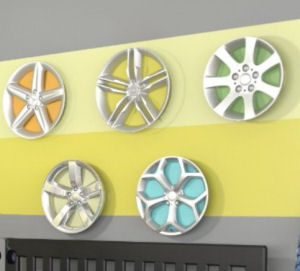 Vintage hubcaps on a baby boy vintage cars theme nursery room wall