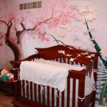 Floral butterfly baby girl nursery with tree mural and pink iris flowers wall mural