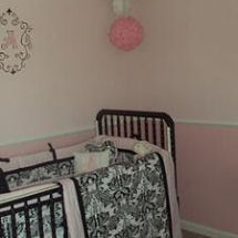 Elegant wall letter monogram with ornate border on a pink white and black baby girl nursery wall