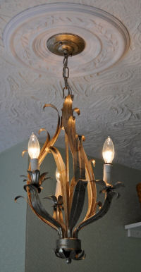 Original antique ceiling light fixture circa 1900 in the nursery of The Davis House Craftsman Style home