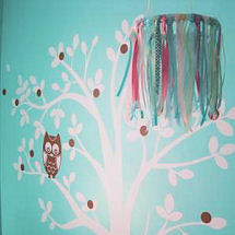 Pink and aqua blue wise owl baby girl nursery with a tree wall decal and ribbon crib mobile