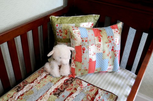 The homemade crib quilt that inspired the vintage nursery design for the historic craftsman style home