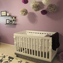 Purple and black baby girl nursery with a modern tattoo theme