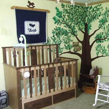 Rustic horse theme baby boy nursery with tree wall mural and homemade horse theme wall hanging
