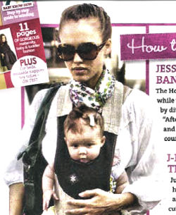 Jessica Alba wearing her stylish Belle Baby Carrier.