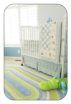 Blue, green and antique white or cream baby boy nursery area rug in a nautical sailboat room
