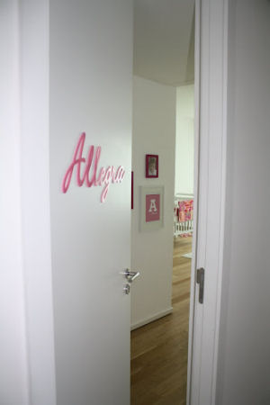 Allegra's name on the nursery door in pretty pink perfect for a baby girl
