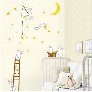 Cute bunny rabbit wall decals and stickers in a neutral yellow pink and white moon and stars theme baby nursery