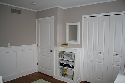 The true white traditional wainscoting in the baby's nursery.