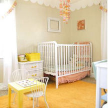 Yellow brown pastel pink and antique white baby girl nursery room decor