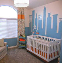 Baby cityscape nursery room with a city skyline wall mural in blue