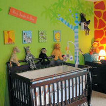 Lime green walls in a baby jungle nursery theme with walls stenciled with zebra stripes and animal prints in wild colors