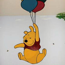 Winnie the Pooh baby nursery with bright painted wall murals