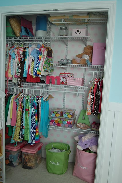 The girls' closet painted in pretty pink polka dots.