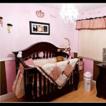 Exotic pink and brown baby girl nursery with wild animal leopard print crib bedding
