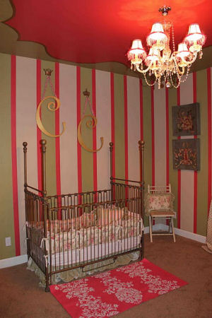 French traditional baby girl nursery room theme with romantic features and painted wall <br>stripes and a unique ceiling