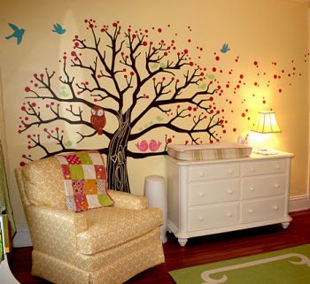 The nursery's tree wall mural from the wise old owl to the pink and blue birds and polka dots are vinyl wall decals and stickers