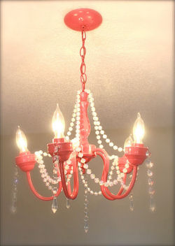 Spray painted hot pink vintage mini chandelier recycled for a baby girl nursery