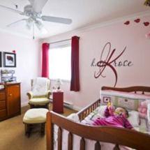 Red and gray baby girl ladybug nursery with large wall name decal