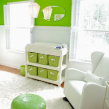 Bright modern neutral lime green and white baby nursery with solid white glider rocker and faux fur flokati area rug