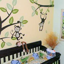 Monkey theme baby girl nursery wall decorated with decals
