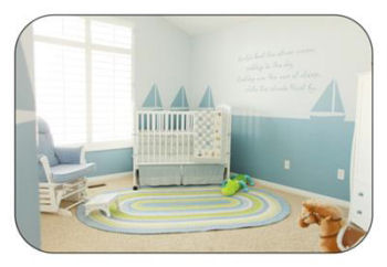 Baby boy nautical theme nursery crib bedding and decor with boat painting technique and wall quotes decals.