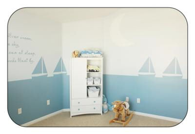 Nautical baby nursery theme decorated with sailboats wall stencils, boat crib bedding and quilts