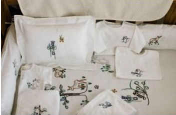 Coyuchi Thor Neutral Organic Baby Crib Bedding Set in a Forest Theme with Wild Woodland Creatures including Baby Deer and other animals