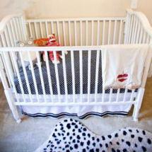 Baby boy neutral nursery with cheetah print area rug