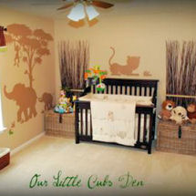 Mama and baby elephants, monkey and tree silhouette art on the walls of a jungle baby nursery theme stenciled with chocolate brown paint