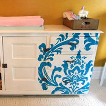 Turquoise blue, white and yellow baby nursery color scheme with custom dresser