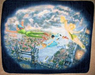 Peter Pan and Tinkerbell fleece blanket that is draped on the rocking chair in the baby's nursery