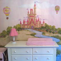 Pink, brown and white princess castle mural in a baby girl nursery