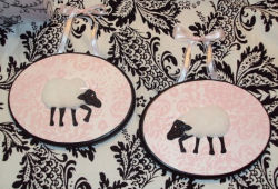 3D White, pink and black baby lamb wooden nursery wall plaques with damask print background.