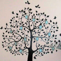 Family tree nursery wall decals decorated with 3D framed black and white photos on a pink wall