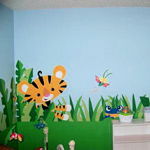 Jungle Rainforest theme neutral baby nursery with tigers and monkeys