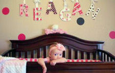 Pink and brown polka dot nursery walls painted with polka dots