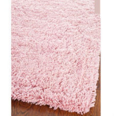 Round pink shag rug for a baby girl nursery room or teen girl bedroom.