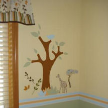 Jungle safari theme baby nursery wall mural with African trees giraffes and leaves