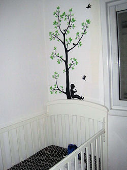 Baby boy and girl swinging on a tree swing with birds silhouette wall decal stickers decorating the wall over the crib in the nursery