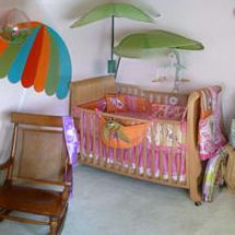 Surfer girl baby nursery with beach theme crib bedding and decor