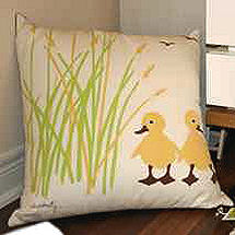 Yellow and green craft sewing project accent pillow for a  neutral baby duck nursery theme with ducky applique crib bedding and unisex decor