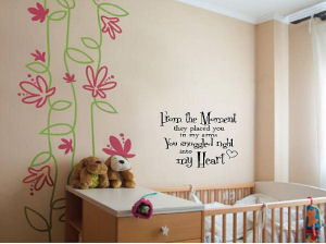 Baby nursery wall quote telling baby how much mom and dad love him or her.