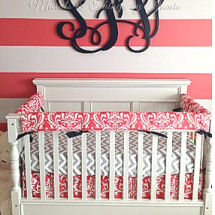 Pink and white painted horizontal wall stripes in a baby girl nursery