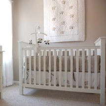 Baby girl taupe and white nursery with a Pottery Barn Kendall crib and dresser