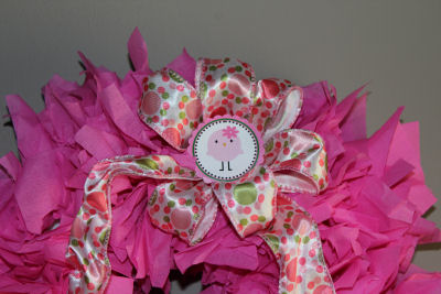 Door wreath made from leftover hot pink baby shower napkins and baby birdy party circles