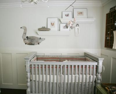 A baby nursery decorated with vintage finds, antique features and a unique homemade mangle cloth and lace crib bedding set.