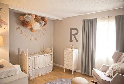 Rylee's peach and gray nursery has many playful, vintage items and custom made decorations.